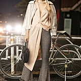 Wear a lightweight champagne top over flared pants and thick boots. Complete with a metallic coat and drop earrings.
