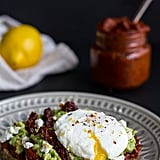 Harissa, Smashed Avocado, and Egg Toast With Goat Cheese and Honey Drizzle