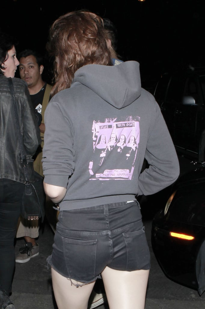 Kristen Stewart wore short black shorts to attended a Florence and the Machine concert.