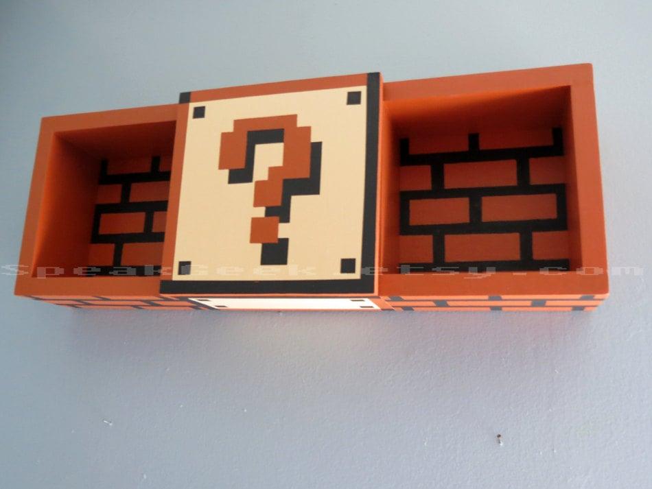 Super Mario Bros. shadow box shelf? We'll take five, thank you.