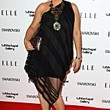 Brix worked a one shoulder black dress with a peacock necklace.