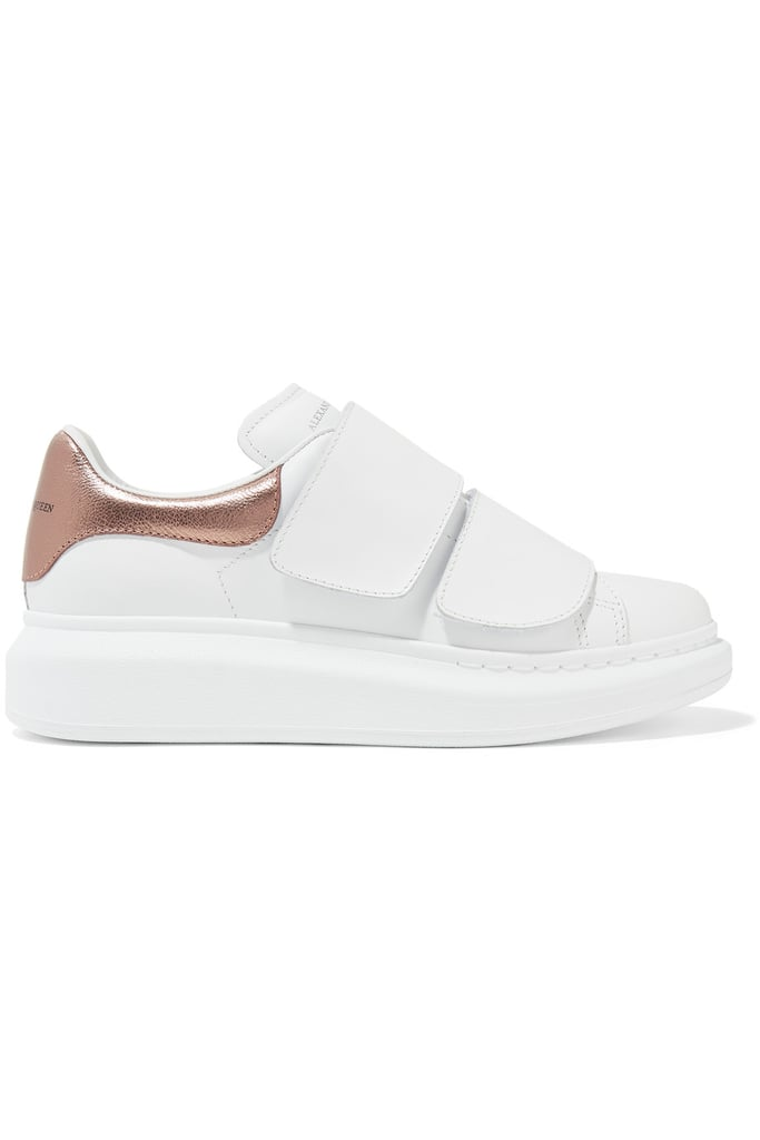 Have a metallic moment in these Alexander McQueen Metallic-trimmed Leather Exaggerated-sole Sneakers ($575).
