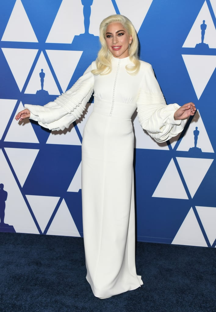 When Lady Gaga enters a room, she doesn't just walk — she glides. At least, that's what it seemed like when she showed up to The Beverly Hilton on Feb. 4 for an Oscars nomination luncheon. Gaga and her fellow A Star Is Born nominees Bradley Cooper and Sam Elliott celebrated their achievements in film ahead of the highly anticipated award show.  Gaga chose a custom high-neck Louis Vuitton gown with statement sleeves for the occasion. She paired the ensemble with matching Giuseppe Zanotti lace-up booties, Yvan Tufenkjian diamond earrings, and, of course, her sparkling engagement ring. Don't mind me . . . I'm just taking notes for my own upcoming wedding. This dress may very well find its way onto my Pinterest board. Ahead, see Gaga's glamorous look from all angles.       Related:                                                                                                           Lady Gaga Wore a Blazer as a Dress, and Damn, She Looked Good!