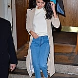 Selena wore the most Fall-ready street style look while out on a dinner date in New York City. She paired yet another pair of frayed jeans with a white top and a suede beige duster.