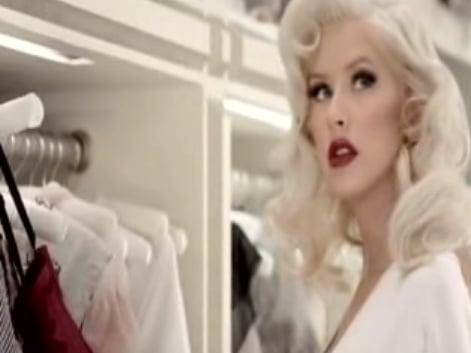 Christina Aguilera Disrobes, Gets Tattooed by Her Perfume