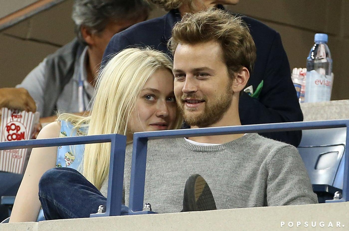 Dakota Fanning cozied up to her boyfriend, Jamie Strachan, during the match.