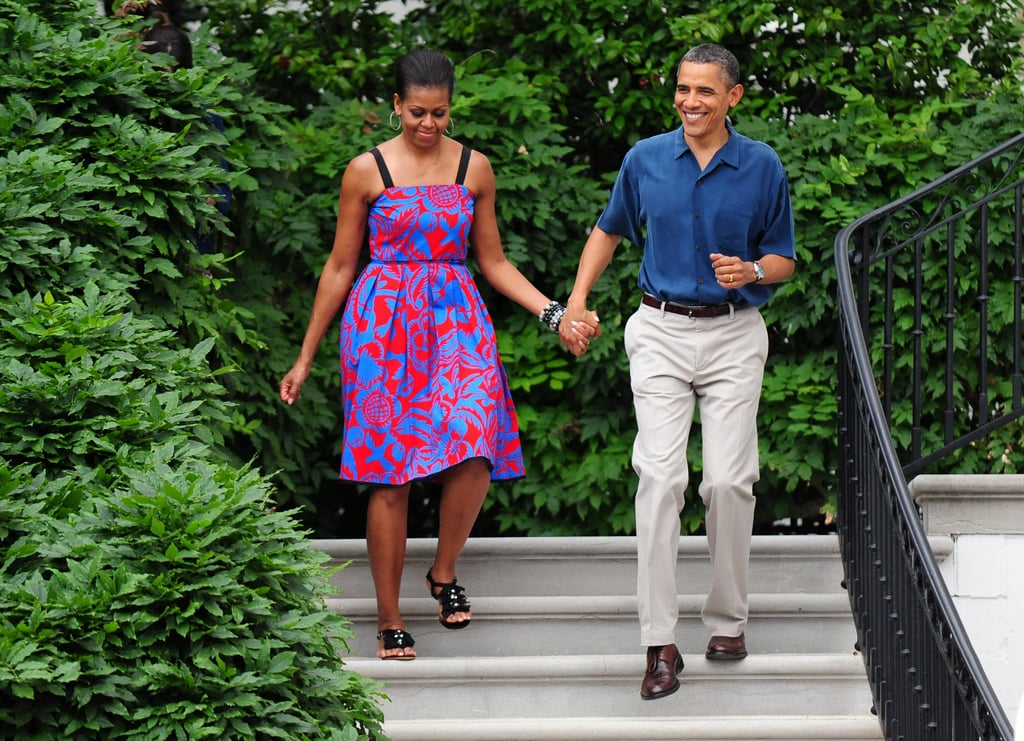 A patriotic Michelle and Barack walked hand in hand on July 4, 2011.