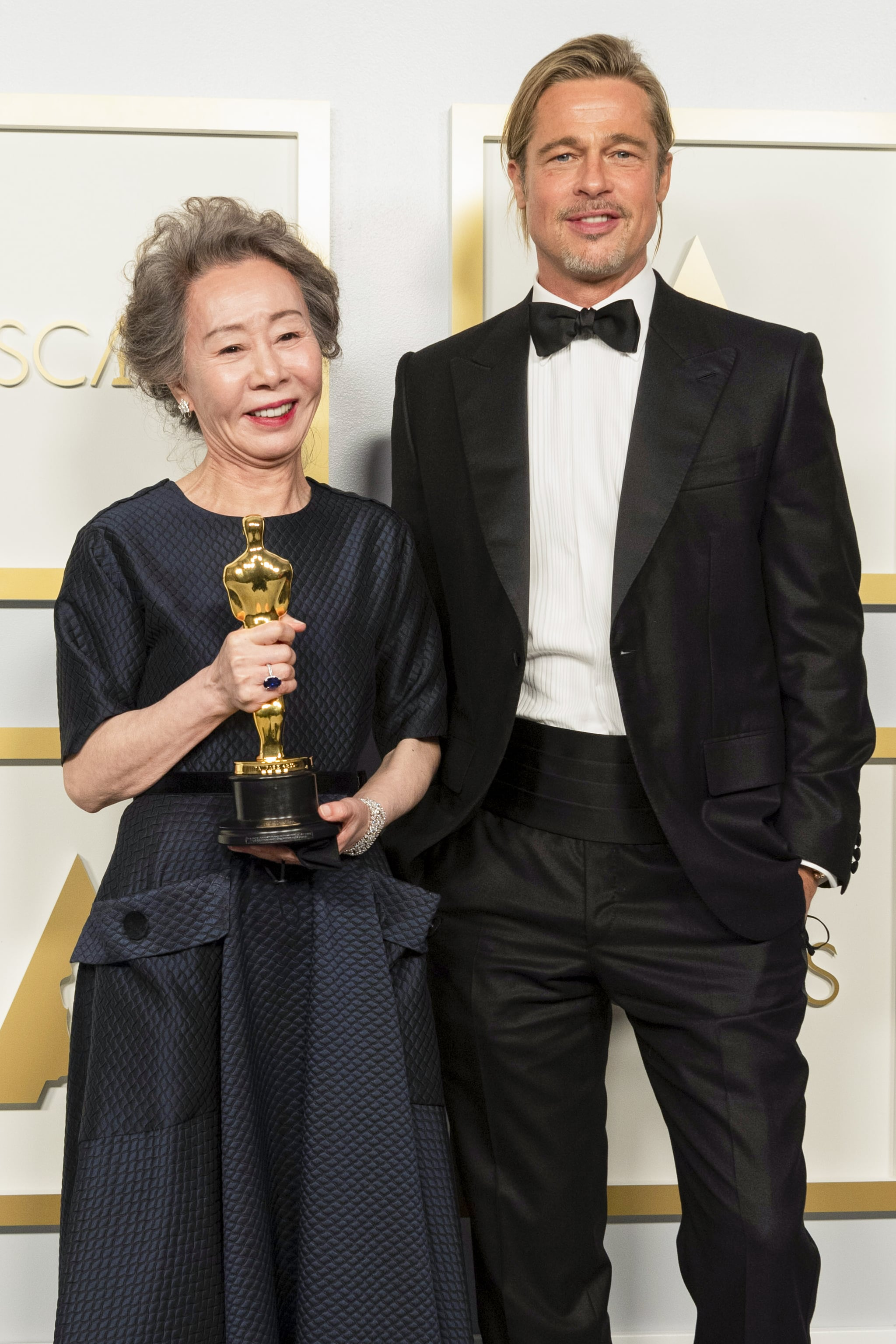 LOS ANGELES, CALIFORNIA – APRIL 25: (EDITORIAL USE ONLY) In this handout photo provided by A.M.P.A.S., Yuh-Jung Youn poses backstage with the Oscar for Actress in a Supporting Role with Brad Pitt during the 93rd Annual Academy Awards at Union Station on April 25, 2021 in Los Angeles, California. (Photo by Matt Petit/A.M.P.A.S. via Getty Images)