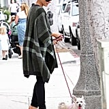 While walking her pup around LA, Kate showcased the perfect toasty and trendy ensemble: plaid Stella McCartney poncho, curve-hugging denim, and rugged Chanel mules.