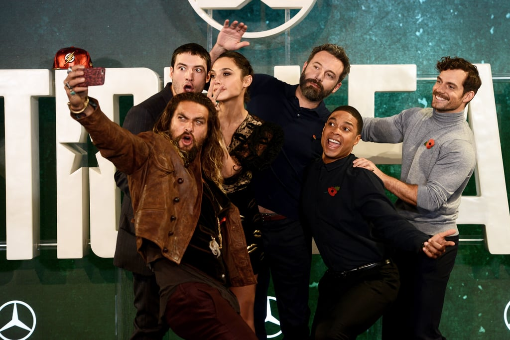 On Friday, the epic cast of the upcoming Justice League movie posed for a few selfies during a photocall for the film out in London. Jason Momoa, who plays Aquaman, held out a phone while his castmates Ben Affleck (Batman), Gal Gadot (Wonder Woman), Henry Cavill (Superman), Ezra Miller (The Flash), and Ray Fisher (Cyborg) made silly faces in the background. The adorable cast looked like one big happy family wearing matching red flower pins. Scroll through to see more photos from the fun event.       Related:                                                                                                           Gal Gadot Teases Upcoming Justice League Film With an Epic Selfie of the Cast