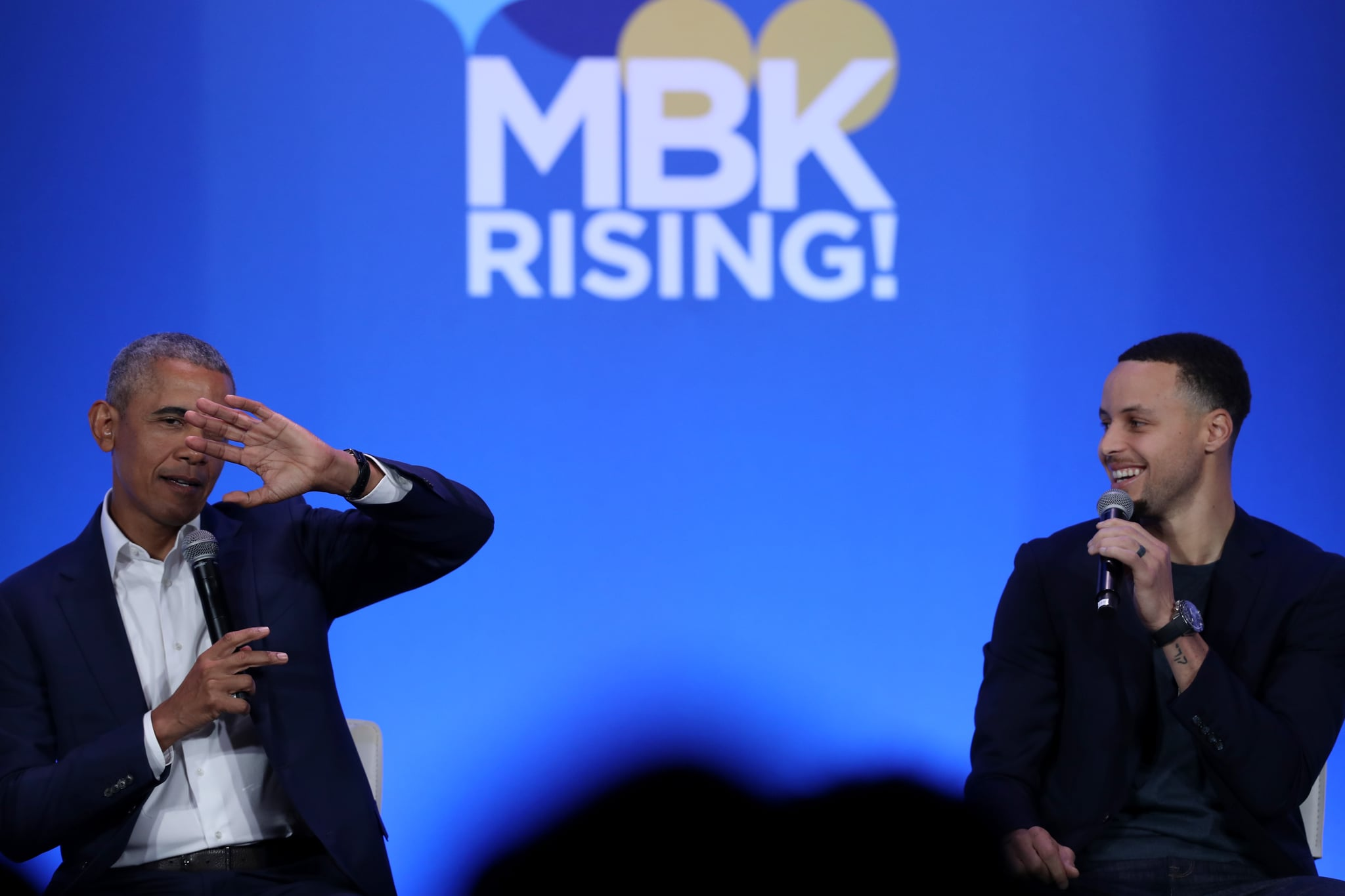 OAKLAND, CALIFORNIA - FEBRUARY 19: Former U.S. President Barack Obama (L) and Golden State Warriors player Stephen Curry speak in conversation during the MBK Rising! My Brother's Keeper Alliance Summit on February 19, 2019 in Oakland, California. MBK Rising! is bringing together hundreds of young men of color, local leaders and organizations that are working to reduce youth violence, create impactful mentorship programs, and improving life for young men of color. The My Brother's Keeper initiative was started by President Barack Obama following the death of Trayvon Martin. (Photo by Justin Sullivan/Getty Images)