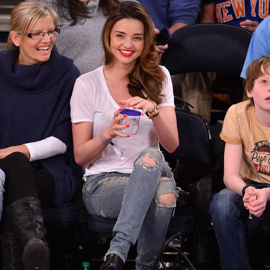Miranda Kerr in White T-Shirt and Distressed Jeans
