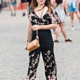 Your festival season outfit is sorted with a floral jumpsuit and casual shoes.