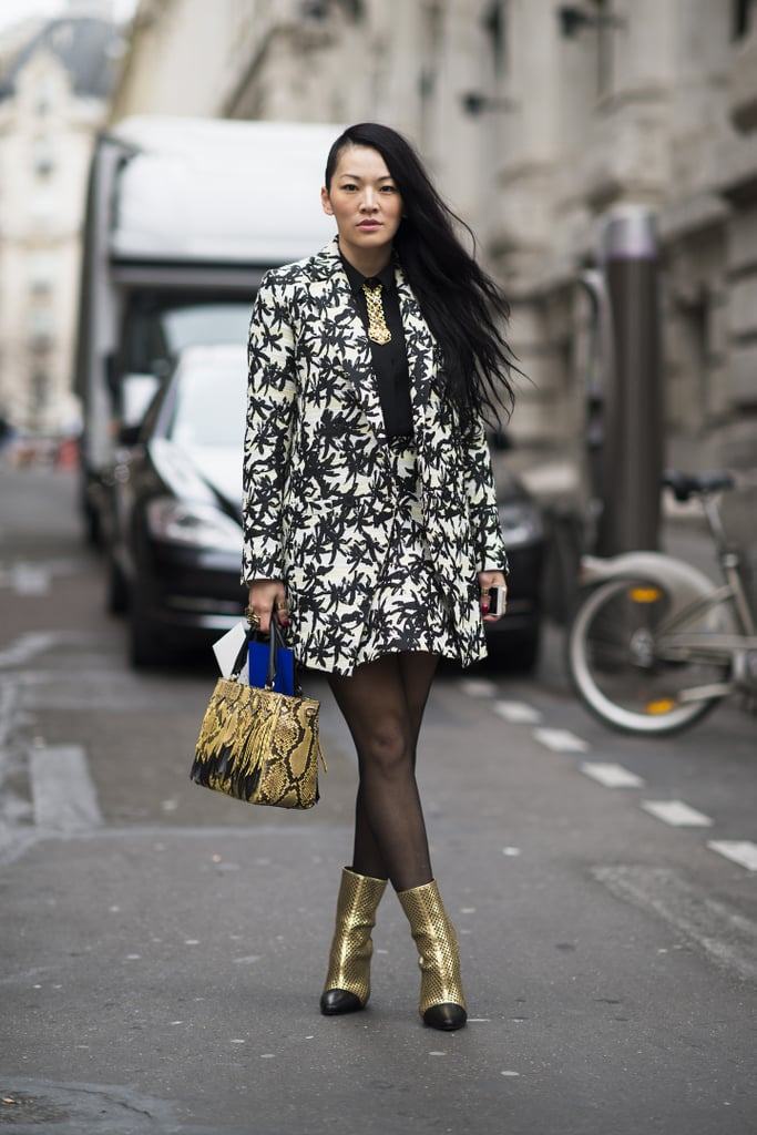 She may have borrowed from the boys up top, but that print and those metallic booties are all woman.  Source: Le 21ème | Adam Katz Sinding