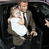 The always-dapper David Beckham carried Harper to lunch at Balthazar in NYC after attending mom Victoria Beckham's show at NYFW.