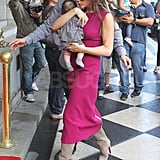 Victoria Beckham looked Fall ready in a dark fuchsia dress paired with suede boots. Doesn't baby Harper look adorable in her black and white outfit?
