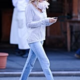 Showing off an even more kick-back look, SJP walked the streets of NYC in lightwash cutoff jeans, a striped long-sleeve tee, a cute scarf, and flat Mary Janes.       Cropped Denim by Notify JeansFlats by Sacha