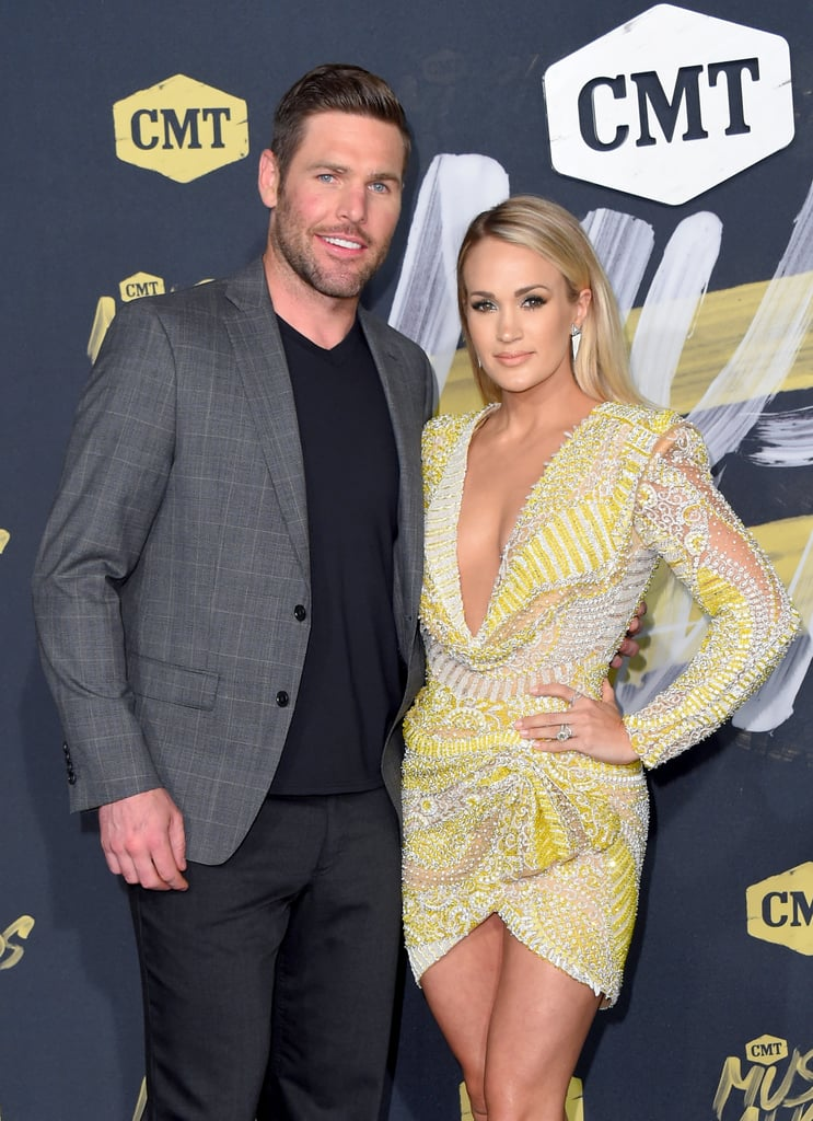 "Carrie Underwood showed up to the CMT Music Awards in Nashville on Wednesday looking like a ray of sunshine. The 35-year-old singer stunned in a sparkly, cleavage-baring dress and was accompanied by her husband, Mike Fisher. Carrie is scheduled to perform later tonight, and she's also nominated for not one but four awards, including video of the year for ""Champion"" and collaborative video with Ludacris for ""The Champion."" Carrie currently holds the record for the most CMT Music Award wins with 17. Good luck to Carrie!       Related:                                                                                                           Carrie Underwood Shares New Details About Her ""Freak Accident"" Last November"