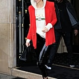 Kendall's greased Zeynep Arçay leggings were finished with a vintage Gucci hoodie and red blazer in Paris.