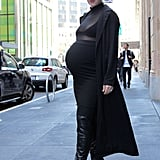 I kept my chest covered with the coat as I walked through the office down to the street, but once I got outside, I had no qualms about baring my black undergarment since I felt so modestly dressed otherwise. I must say, Kim's duster coats are actually genius. They hide the butt, which inevitably grows while you're growing a human, and make the skin-tight, often sheer ensembles feel a lot less revealing.  I actually felt more self-conscious walking through my office full of gawking (and extremely encouraging) co-workers than I did on the street being stared at by strangers (maybe due to the fact that half my face was hiding behind huge dark sunglasses a la Kim?).  So, my first step into Kim K's shoes wasn't that bad — well, it was pretty comical walking in five-inch platform over-the-knee, open-toe boots while trying to balance my expanding stomach — but otherwise, not that bad.