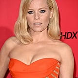 Elizabeth Banks wore a flattering orange dress.