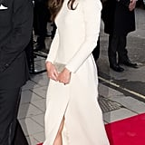 Kate Middleton followed Angelina Jolie's Oscars lead by her flashing her leg with a thigh-high split.