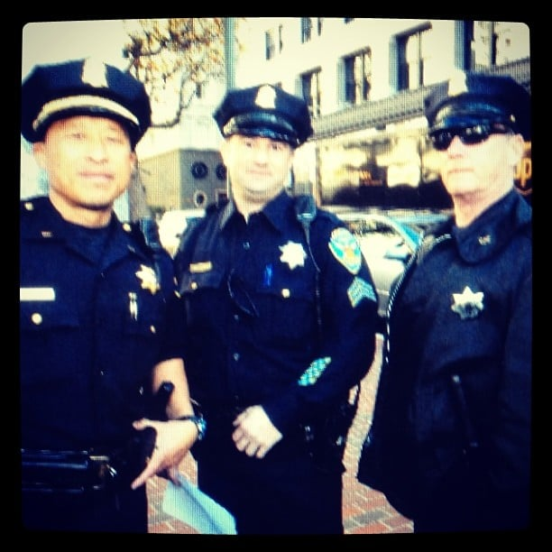 Police were on hand to escort Batkid to the first scene of the crime. Source: Instagram user trishaleeper