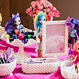 If you're not familiar with Equestria girls, they are a fashion doll version of the My Little Pony characters with colored hair, bright outfits, lots of personality.  We placed Ally's dolls around the table, again, using what we already owned as decor.