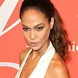 Joan Smalls's penetrating gaze was made more dramatic by her dark gray smoky eye and bold brows, and her hair was pulled back to emphasize her gorgeous face.