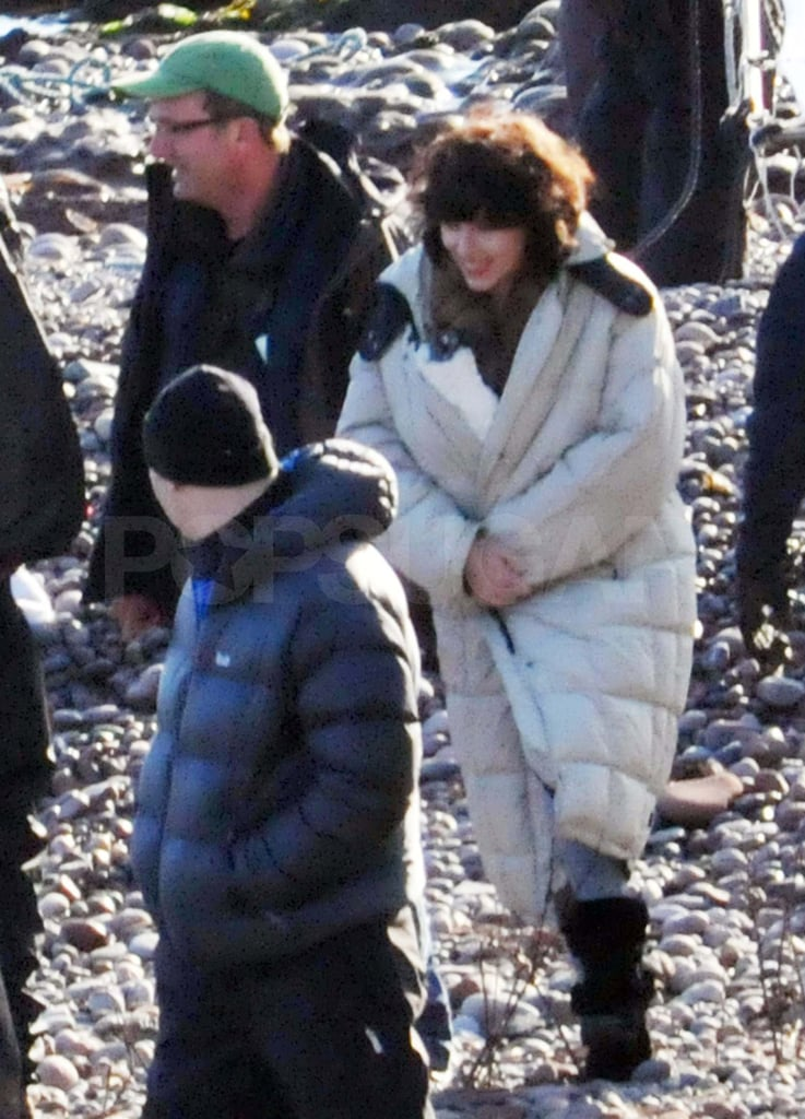 Scarlett Johansson bundled up in a puffy coat on the set of Under the Skin in Scotland today. She was back in her dark wig for the day of filming after debuting her brown locks when she was first spotted in character last week. Scarlett may be overseas for work, but she's still making headlines stateside for her recent nude photo scandal. Scarlett told Vanity Fair that the racy pictures were intended for her then-husband Ryan Reynolds and maintains that there's nothing wrong with sharing the sexy shots in private.  Scarlett will be back in the spotlight for a different body of work soon as she stars promoting her holiday release, We Bought a Zoo. She finished production on the movie with Matt Damon earlier this year. Scarlett shares the screen with Matt in the We Bought a Zoo trailer we had a peek at back in September.