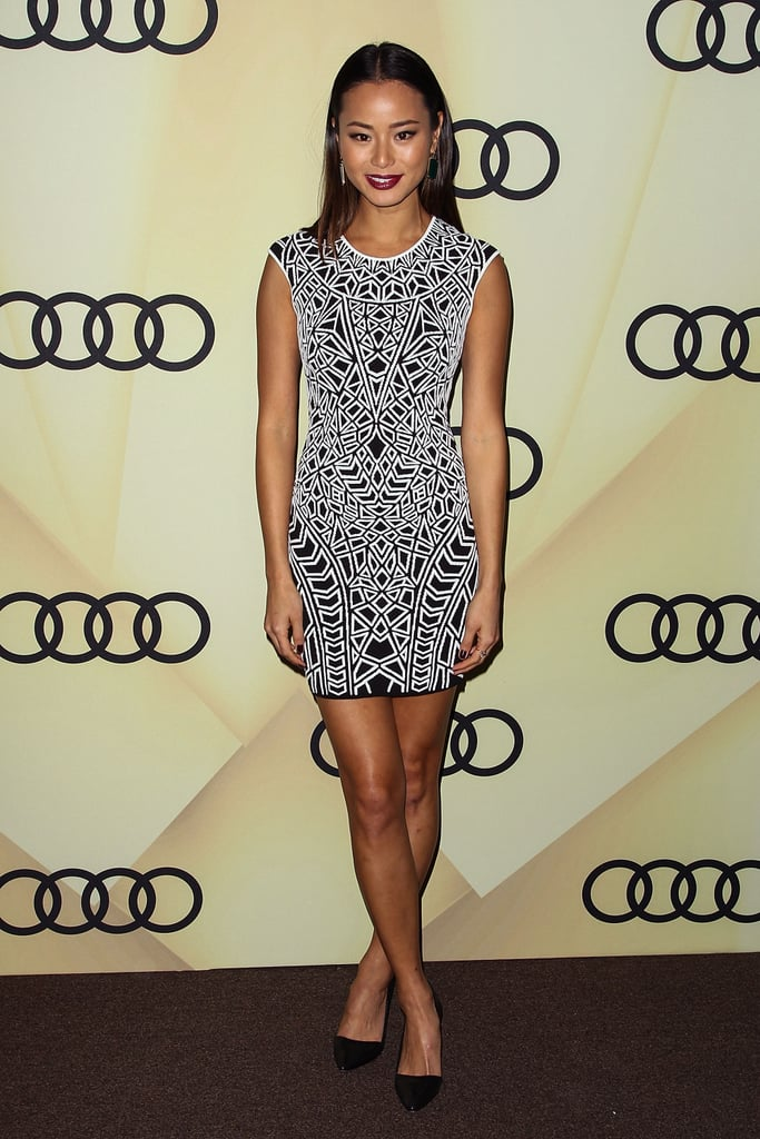 Jamie Chung showed off her stems in a sleeveless printed minidress, but kept it simple elsewhere. Sleek straight hair, a berry lip, and classic black pumps completed the ensemble.