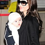 In January 2009, Angelina Jolie carried Vivienne Jolie-Pitt through the airport in Japan.