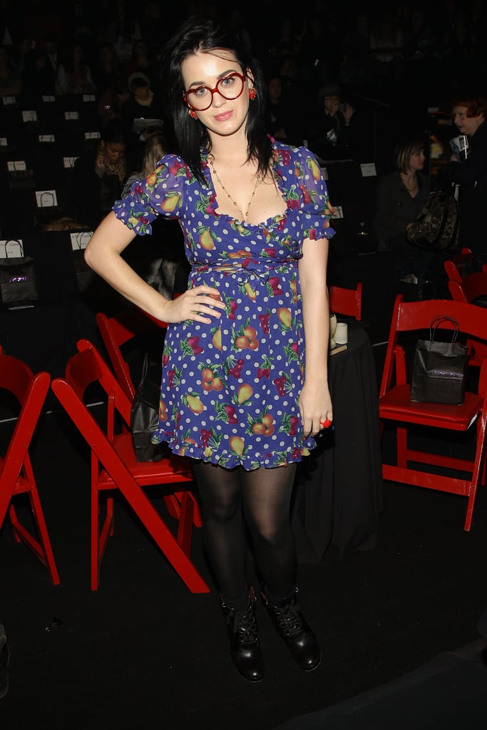 Geek chic in a fruit-print babydoll dress, heart-shaped glasses, and tough combat boots sat front row at Betsey Johnson's Fall 2008 show during New York Fashion Week.