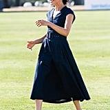 Meghan rocked her Aquazzura bow slingbacks with a denim Carolina Herrera dress at the polo in July 2018.
