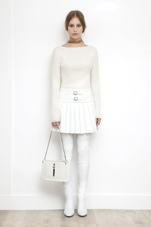 Knit Boatneck Top With Pleated Skirt Combo Dress in Cream, Sweet Revenge Stretch Nappa Legging Boot in Cream, Attraction Patent Shoulder Bag in Cream. Photo courtesy of Tamara Mellon