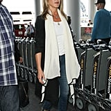 Jen owns these Burberry wedges in cognac, too, but we think the black version can be worked seamlessly from a.m. to p.m., and we like that a lot. Jen wore them to LAX to board a flight in July 2016.