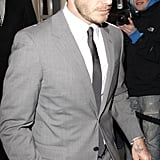David Beckham in a gray suit.