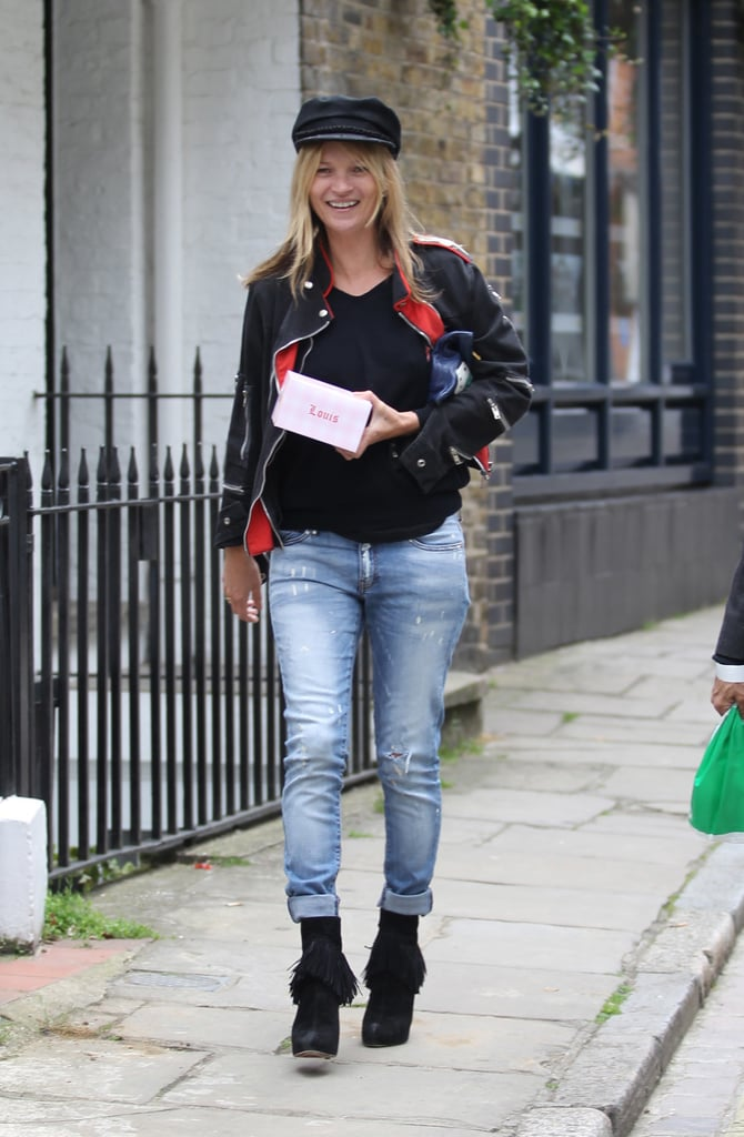 Straight-leg jeans got a Moss twist when Kate rolled up the hems of her vintage-look jeans to show off her slouchy boots.