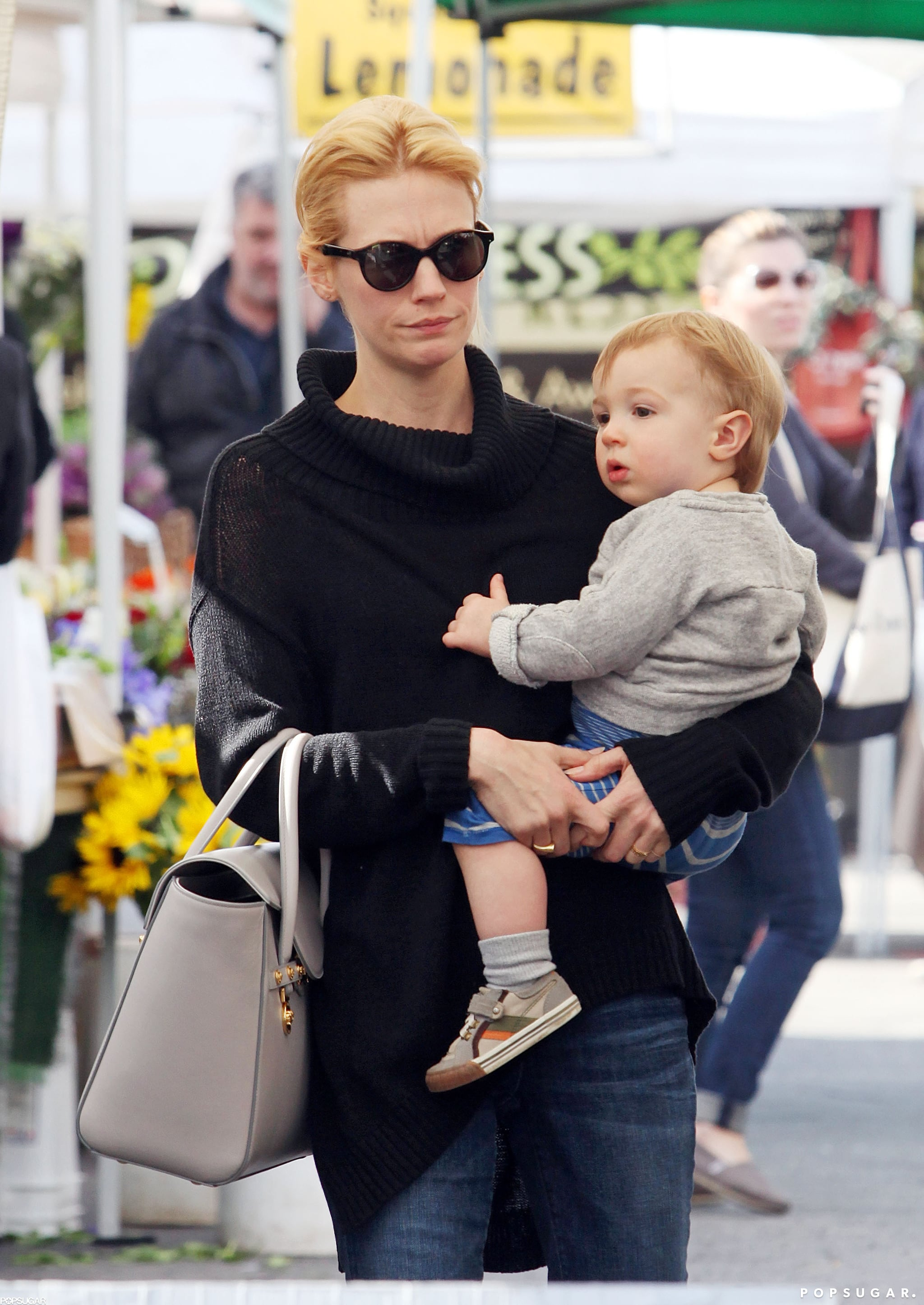 January Jones stopped by an LA farmers market with son Xander Jones.