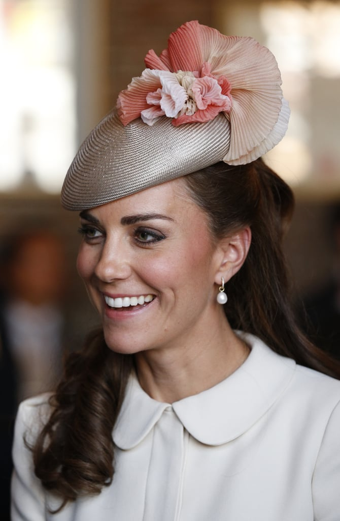 Kate wore a peach ruffle Jane Taylor cocktail hat at a remembrance service in Belgium, 2014.