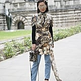 Anyone can rock a minidress, but fashion stylist Liz Uly made it street style worthy by wearing her Christopher Kane number with a long-sleeved shirt and Acne jeans. Eye-catching accessories like a Louis Vuitton bag and Giuseppe Zanotti heels completed the outfit.