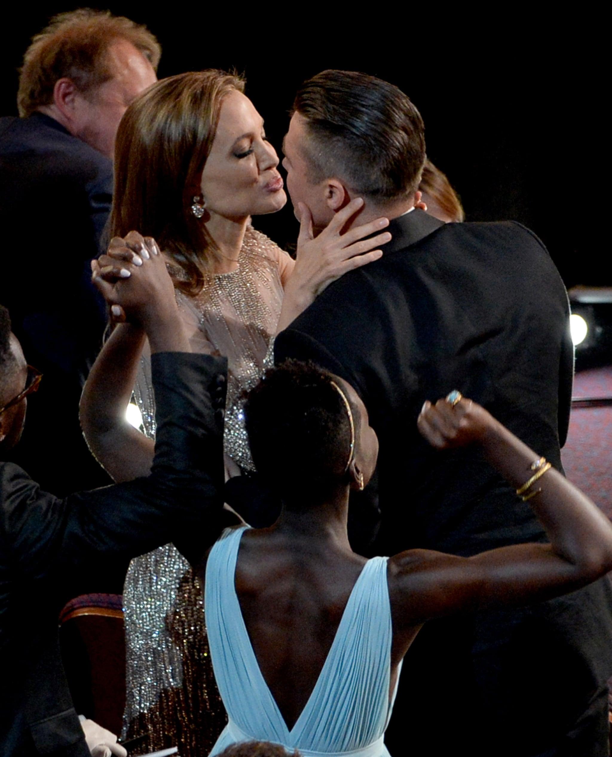 Brad Pitt and Angelina Jolie puckered up at the Oscars.