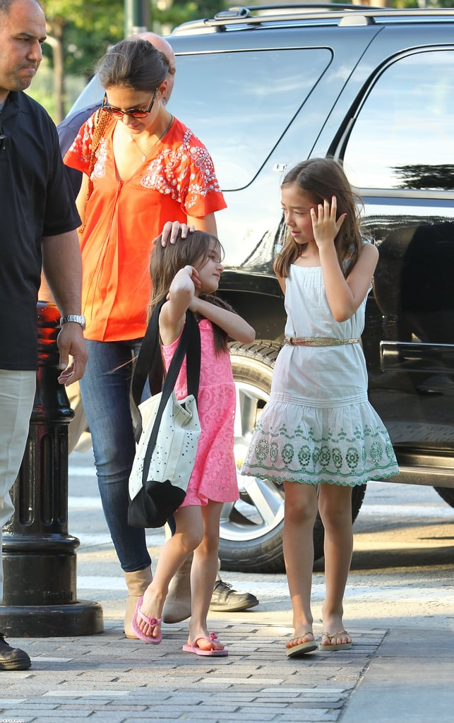 Katie Holmes patted Suri Cruise on the head.