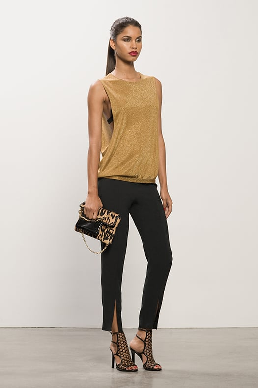 Lurex Gold Tank ($450), Cashmere Black Bra ($125), Crepe Black Cigarette Pant ($550), Submission Black Studded Sandal ($995), TM Feel Leopard Pony Bag ($895) Photo courtesy of Tamara Mellon