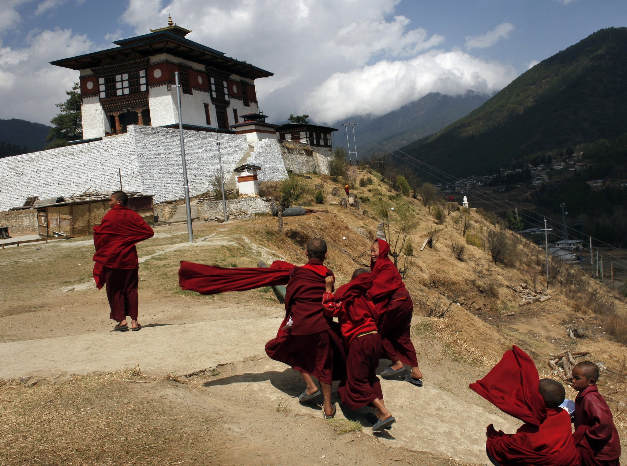 Young monks walk back to class after lunch.
