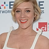 Chloë Sevigny shows the perfect way to do your makeup with a pixie cut: add a pop of color to your lips!