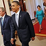 Smiling at the unveiling of the Bushes' presidential portraits in 2012