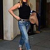 Wearing a black crop top with cuffed jeans and Gucci mules in September 2016.
