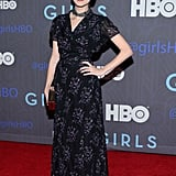 Nora Zehetner punched up a floral maxi dress with a shiny box clutch and a chunky choker-like necklace.
