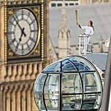 Explorer Amelia Hempleman-Adams held the Olympic torch atop one of the pods on the London Eye in central London.